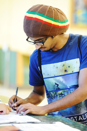 Globe | T. Rob Brown<br /> Abdulrahman Alshaeri, an MSSU freshman chemistry major, registers to vote Tuesday morning, Sept. 24, 2013, at the Lions Den in MSSU's Billingsly Student Center.