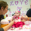 Globe/Roger Nomer<br /> Leslie and BJ Harris present their daughter Delylah with a birthday treat at Children's Mercy Hospital on Friday.