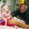 Globe/Roger Nomer<br /> BJ Harris plays with his daughter Delylah as she recovers at Children's Mercy Hospital on Friday.