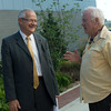 Globe/Roger Nomer<br /> Joplin Superintendent Norm Ridder talks with Jon Fowler, artist of the bronze eagle, on Wednesday in the Joplin High Rose Garden.