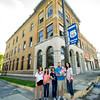 The Powell family stands outside the old First National Bank Building in Carterville on Friday. Brock Powell, of Powell's Construction and Flooring, plans to renovate the building into four large apartments, with retail space on the groundfloor. Pictured, from the left: Madison Nash, 12, Jadyn Fox, 11, Makenna Powell, 11, Brock Powell, Vivian Powell, 3 months and Courtney Powell.<br /> Globe | Laurie Sisk