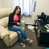 Emily Epperson, receptionist at Webb City's YMCA Heritage Youth Development Center, sits in the recliner inside the center's lactation room that she uses while breastfeeding her second child.<br /> Globe | Laurie Sisk