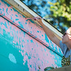 Globe/Roger Nomer<br /> Jenny Journeycake works on the East Town mural on Wednesday afternoon. A ribbon cutting for the finished mural will take place on Sunday at 2 p.m.