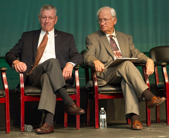 Joplin Historical Society President Allen Shirley, right, listens as he sits beside former U.S. Attorney General John Ashcroft during an unveiling of a copy of the front page of the Sept. 11, 2001 special edition of The Joplin Globe signed by former President George W. Bush, former U.S. Attorney General John Ashcroft, former New York City mayor Rudy Giuliana and others during a special ceremony on Saturday at Missouri Southern. The signed special edition will be on display at the Joplin Museum Complex.<br /> Globe | Laurie Sisk