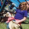 Globe/Roger Nomer<br /> A goat takes a taste of Cadence Martensen's sweater as the Neosho Middle School fifth grader pets it on Thursday at the Neosho School Farm.