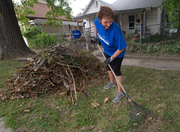 Patty Starchman, of Central City Christian Church, helps rake yards on South Sergeant during the Great Day of Service on Sunday. Starchman was one of about 70 members of the church who volunteered their services on Sunday.<br /> Globe | Laurie Sisk