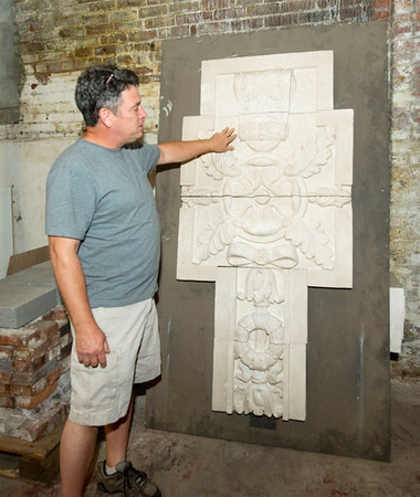 Contractor Jeff Neal, of Neal Group Construction,  stands near an ornate piece he saved from renovations to the Gryphon Building. Neal is responsible for the renovation of close to 20 older buildings in Joplin, primarily in the downtown area. <br /> Globe | Laurie Sisk