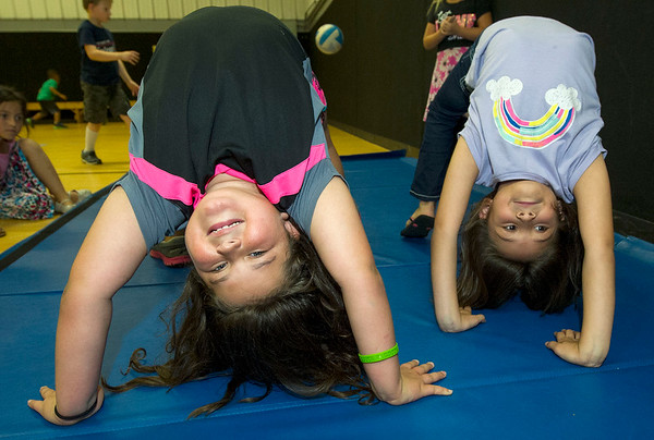 Eight-year-olds Dasia Pittsley, left and Sophia Giddens practice backbends during the afterschool program on Tuesday at the Boys and Girls Club of Southwest Missouri.<br /> Globe | Laurie Sisk