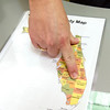 Community Blood Center of the Ozarks supervisor Mary Conner points out a map of the three Florida counties that are currently of concern because of the Zika virus. Persons who have traveled to Palm Beach, Miami-Dade or Broward counties in Florida must wait 28 days from their return before they can donate at the center.<br /> Globe | Laurie Sisk.