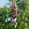 Globe/Roger Nomer<br /> Kristian Engle, a Missouri Southern sophomore from Fort Scott, rides on a zipline on Wednesday at Missouri Southern.