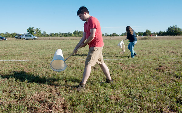 Globe/Roger Nomer<br /> Teddy Pashia, a Missouri Southern junior from Webb City, and Rachel Denton, a senior from Lake of the Ozarks, sweep for insects on Tuesday at the MSSU prairie.