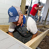 "Lonnie Stansberry, front, and Ryan Peterson build a new ADA ramp at the Carthage home of Ron Erskin on Saturday. The two were part of 120 volunteers from Habitat for Humanity's ""Brush with Kindness"" program and Hearts and Hammers who helped beautify 16 sites in Webb City, Carthage, Carl Junction and Joplin on Saturday.<br /> Globe 