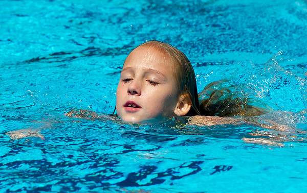 Nine-year-old Harlea Drury, of Baxter Springs, enjoys a swim on Saturday at Schifferdecker Pool during the last weekend of the season for Joplin city pools. <br /> Globe | Laurie Sisk