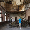 Brock Powell, of Powell's Construction and Flooring, stands amongst the rubble of the interior of the old First National Bank Building in Carterville on Friday. Powell plans to renovate the building into four large apartments, with retail space on the groundfloor.<br /> Globe | Laurie Sisk