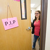 Emily Epperson, receptionist at Webb City's YMCA Heritage Youth Development Center, closes the door to center's lactation room that she uses while breastfeeding her second child. The Pumping in Progress sign allows privacy for nursing mothers.<br /> Globe | Laurie Sisk