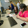 Crowder College freshman Amselin Ramirez, front and Ana Reyes-Mojica study together in the College Assitance Migrant Program lab on Wednesday at Crowder College.<br /> Globe | Laurie Sisk