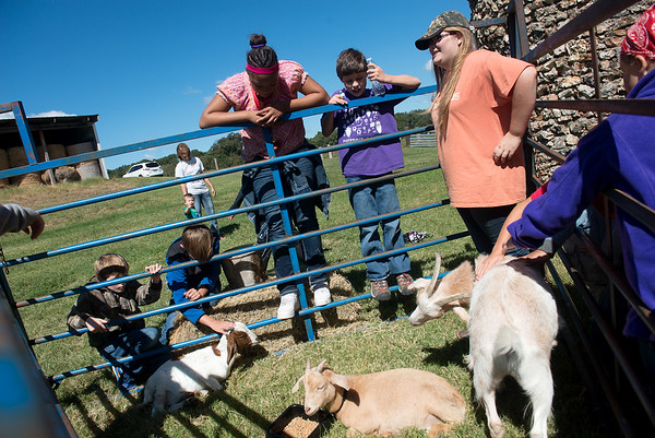 Globe/Roger Nomer<br /> Elizabeth Rose, a Neosho High School sophomore, shows goats to Neosho Middle School students on Thursday at the Neosho School Farm.