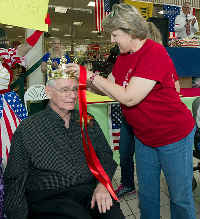 Shelley Gromer, of Pittsburg's Guest Home Estates, crowns Danny Bitner, of Guest Home Estates as king of assisted living during the Little Balkans 22nd Annual Senior King and Queen Pageant on Friday at Pittsburg's Meadowbrook Mall.<br /> Globe | Laurie Sisk