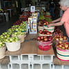 Globe/Roger Nomer<br /> Betty Edgar stocks apples on Tuesday at Murphy Orchard.
