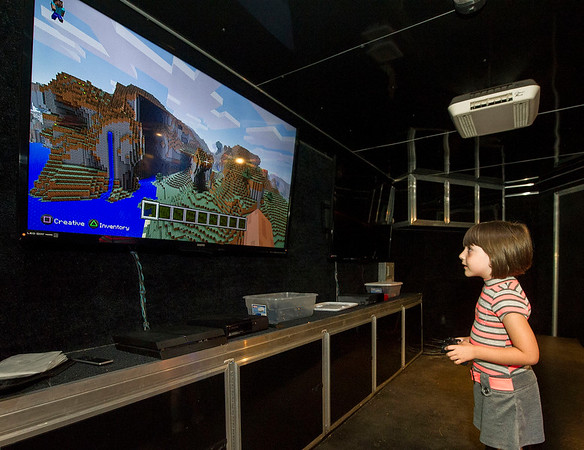 Seven-year-old Kenzie Bryant plays a game of Minecraft in her family's rolling video trailer at their Neosho hme on Wednesday.<br /> Globe | Laurie Sisk