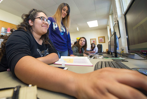 Crowder College students Carmen Renteria and Ashley Barrera study together in the College Assitance Migrant Program lab on Wednesday at Crowder College.<br /> Globe | Laurie Sisk