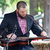 Dan Shilling, of the Borderline bluegrass band, entertains the crowd during the Carl Junction Bluegrass Festival on Saturday at Center Creek Park.<br /> Globe | Laurie Sisk