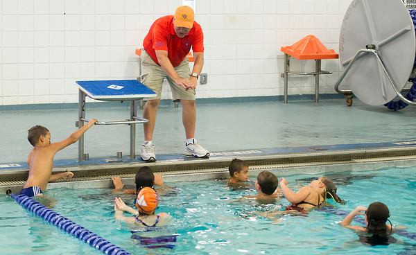CatTracks swim coach Lyman Burr, top, talks technique with his swimmers last week at the Fair Acres Family YMCA in Carthage.<br /> Globe | Laurie Sisk