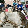 Three-year-old Lillie Cusick enjoys her first pony ride during the Neosho Fall Festival on Saturday in downtown Neosho.<br /> Globe | Laurie Sisk