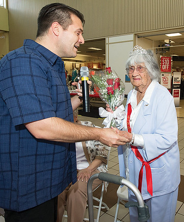 Dalton Windsor, left, serenades Gertrude McKinney as assisted livin queen during the Little Balkans 22nd Annual Senior King and Queen Pageant on Friday at Pittsburg's Meadowbrook Mall.<br /> Globe | Laurie Sisk