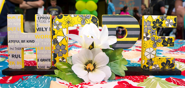 A simple, colorful message sits on the Stapleton Elementary Third Thursday booth in downtown Joplin.<br /> Globe | Laurie Sisk