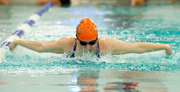 Jacey Dixon, 13, works on her butterfly stroke with the CatTracks swim team last week at the Fair Acres Family YMCA in Carthage.<br /> Globe | Laurie Sisk