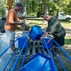 Globe/Roger Nomer<br /> Jed Schlegel and Jorge Leyva set up a sculpture on Thursday at Leyva's studio.