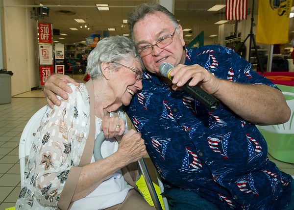 John Scott serenades Arlene Phippeaux, of Via Christ Village during the Little Balkans 22nd Annual Senior King and Queen Pageant on Friday at Pittsburg's Meadowbrook Mall.<br /> Globe   Laurie Sisk