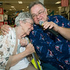 John Scott serenades Arlene Phippeaux, of Via Christ Village during the Little Balkans 22nd Annual Senior King and Queen Pageant on Friday at Pittsburg's Meadowbrook Mall.<br /> Globe | Laurie Sisk