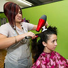 Small business owner Marlene Sosa talks politics with client Lakin Jackson at her beauty salon, Marlene Sosa's Hair Dressing on Thursday in Noel. Sosa said she cannot find a candidate she wishes to support.<br /> Globe | Laurie Sisk