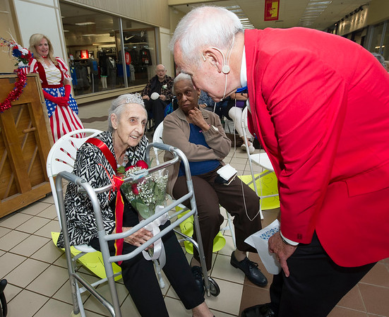 Emcee Joe Hart congratulates Katherine Farmer, of Via Christi Village, after she was named Queen for longterm care during the Little Balkans 22nd Annual Senior King and Queen Pageant on Friday at Pittsburg's Meadowbrook Mall. Farmer turns 93 in two weeks.<br /> Globe | Laurie Sisk
