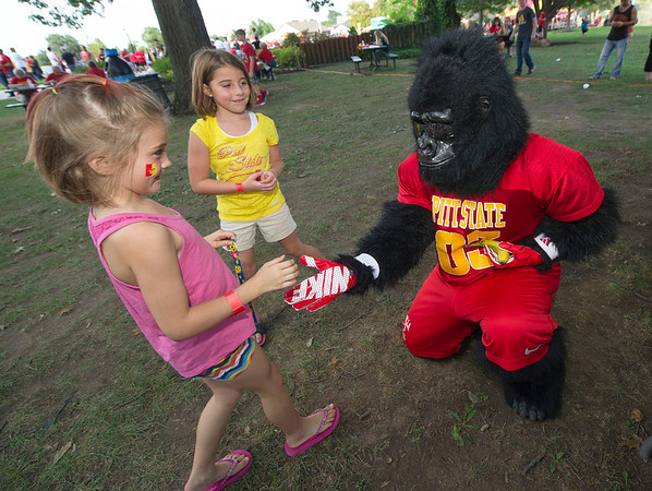 From the left: Veda Cummins, 7 and Jasmine Camp, 6, meet Gus the Gorilla during Gorilla Fest on Thursday night at Gorilla Village in Pittsburg.<br /> Globe | Laurie SIsk