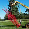Globe/Roger Nomer<br /> Charlie Smith, left, and Jed Schlegel help set up a Jorge Leyva sculpture on Thursday afternoon.