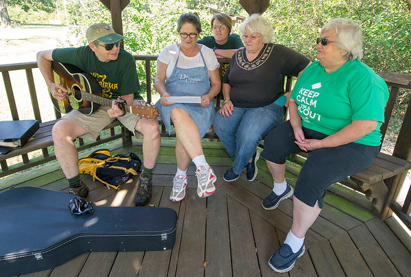 "From the left: From the left: Camp Mintahama alumnae Judy Russell, of Pittsburg, Kathy Myers, of Lamar, Joyce Bush, of Lake of the Ozarks, Vicki Cassady, of Carl Junction and Mavis Bowen, of Columbus, join in a sing-a-long of a traditional Girl Scout song, ""On My Honor,"" on Friday before the start of the Camp Mintahama Reunion Roundup, which takes place this weekend at the camp. <br /> Globe 