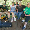 """From the left: From the left: Camp Mintahama alumnae Judy Russell, of Pittsburg, Kathy Myers, of Lamar, Joyce Bush, of Lake of the Ozarks, Vicki Cassady, of Carl Junction and Mavis Bowen, of Columbus, join in a sing-a-long of a traditional Girl Scout song, """"On My Honor,"""" on Friday before the start of the Camp Mintahama Reunion Roundup, which takes place this weekend at the camp. <br /> Globe 