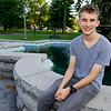Fifteen-year-old Noah Elliott sits beside a fountain on Thursday at Central Park in Carthage. The Carthage High School sophomore is currently in his second bout with eye cancer.<br /> Globe | Laurie Sisk