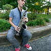 Fifteen-year-old Noah Elliott plays his saxophone on Thursday at Central Park in Carthage. A second bout with eye cancer hasn't prevented the Carthage High School sophomore from pursuing his love of music.<br /> Globe | Laurie Sisk