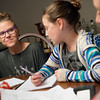 Globe/Roger Nomer<br /> Mandy Gaston helps her partner's daughter Lily Compton, 8, with her homework on Wednesday evening.