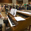 Pittsburg High School choir instructor Susan Laushman leads the Pittsburg Multi-generational choir during rehearsal on Thursday at PHS.<br /> Globe | Laurie Sisk