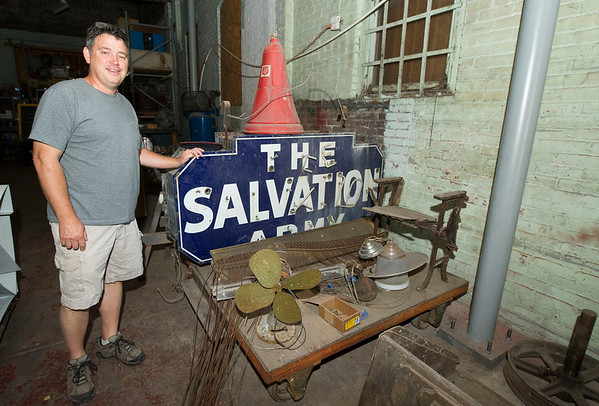 Contractor Jeff Neal, of Neal Group Construction, stands near some of the artifacts he has recoverd from the Hurlbut Building that he is renovating for office space on at 212 S. Joplin. The building, which was constructed in 1921 and was first used as a mortuary, later housed the Salvation Army for decades.<br /> Globe | Laurie Sisk