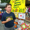Stapleton fifth grader Ryan Replogle gives a brief explanation of Cardiac Sarcoma to Third Thursday visitors in downtown Joplin.<br /> Globe | Laurie Sisk
