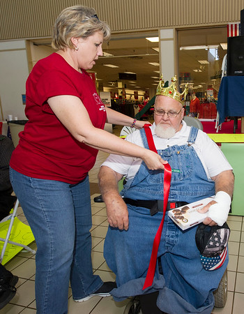 Shelley Gromer, of Pittsburg's Guest Home Estate, crowns Jerry Hoban, of Medicalodge Pittsburg as long term care king during the Little Balkans 22nd Annual Senior King and Queen Pageant on Friday at Pittsburg's Meadowbrook Mall.<br /> Globe | Laurie Sisk
