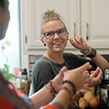Globe/Roger Nomer<br /> Mandy Gaston talks with her partner Anne Compton while preparing dinner on Wednesday evening.