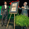 From the left: Joplin Globe Publisher Michael Beatty and Joplin Historical Society President Allen Shirley unveil a signed copy of the  September 11, 2001 special edition front pag signed by former President George W. Bush, former U.S. Attorney General John Ashcroft, former New York City mayor Rudy Giuliana and others during a special ceremony on Saturday at Missouri Southern. The signed special edition will be on display at the Joplin Museum Complex.<br /> Globe | Laurie Sisk
