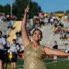 Feature twirler Lauren Dawald performs with the Lion Pride Marching Band prior to the start of Missouri Southern's football game against Missouri Western on Saturday at Fred G. Hughes Stadium.<br /> Globe | Laurie Sisk